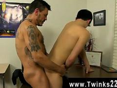 gay tattooed up hunk fucking the twinks ass