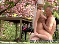 busty blonde has the old dude to fuck under the tree