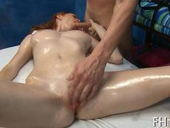Oiled up redhead gets her gorgeous body blasted with dick