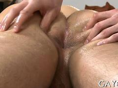 Gay stud gets oiled up and touched all over