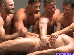 Muscular gay group playing a little sex game