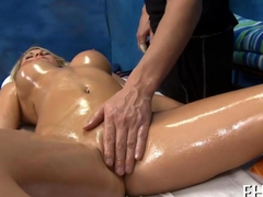 busty babe gets her oiled up cunt finger fucked