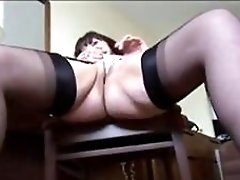 Wrinkled MILF in stockings plays with her dildo