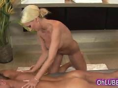 Sexy sexy blonde gives oiled body massage