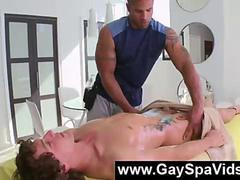 Tattooed gay guy giving a massage to naked straight dude