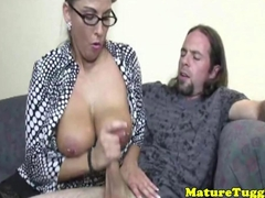 Glamour milf jerks cock off over pierced tits
