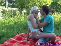 Blonde teen fucks outside