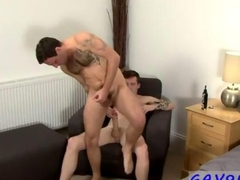 Inked up gay dude gets a doggy style fucking