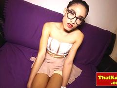 Thai tgirl shemale with glasses jerks