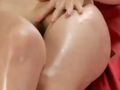 Oiled Up Asian Girl Fingering Her Pussy