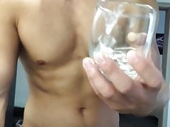 A young pretty boy jerks off, cums and cum eating