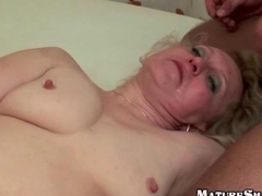 Blonde Granny Jizzed By two Guys