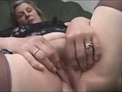 mature slut is on the bed getting rowdy herself