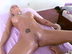 Blonde babe massaged with oil all over