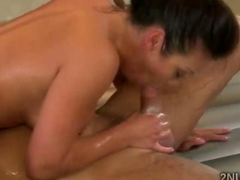 Oiled brunette masseuse mounts huge dong druing Nuru session