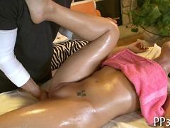 oiled up and she has a nice massage to endure