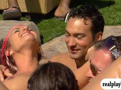 Group of swingers enjoying some oral sex by the pool