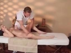 Busty blonde blows cock after massage