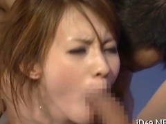 Voracious Asian slut gets her face stuffed in a threeway